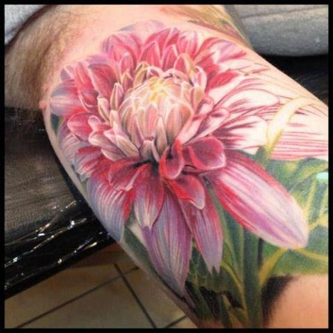 Gorgeous flower tattoo. Great color and detail.