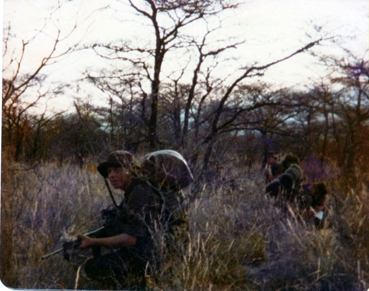 Not a great photo but the only one I have of 3 SAI training at Mosita 1979 prior to going to SWA. Note the big sleeping bag on the back and the aerial of the platoon radio. You can see in the background a troopie with his full blanket roll. Ironic that we trained for the border with conventional warfare approach to training in what we carried.