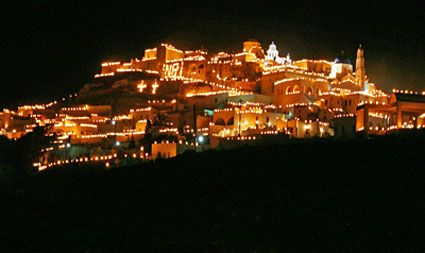 in pirgos,a very old village.this is a traditional custom during easter.all those lights are lighten cans filled with oil.