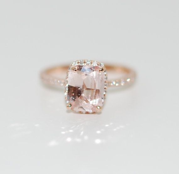 White sapphire Engagement ring by Eidelprecious. Rose gold engagement ring with White sapphire. This ring features a 3.03ct cushion sapphire, SI/I (some visible inclusions). The stone is unbelievable - clear and beautiful. It is a natural non-treated stone, very rare. The color changes from pastel peachy champagne to white. Very pretty! This beauty is set in a 14k rose gold diamond setting. Size 6, we resize for free.  Details: Main Stones Origin: Natural, not created Clarity SI Accented...