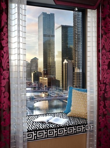 Hotel Monaco Chicago.  All the guest rooms have cushioned window seats.  For the best view, ask for the river-view rooms!