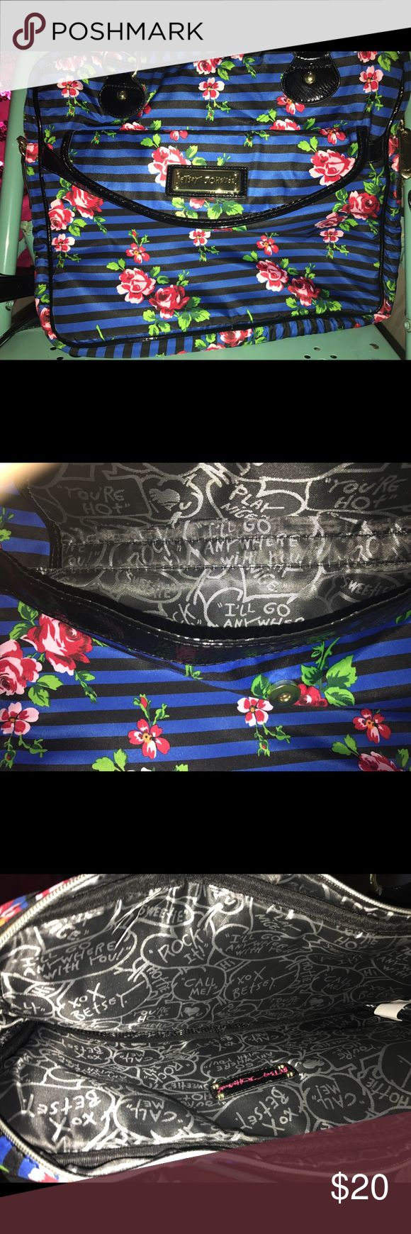 Laptop Bag This is a large laptop bag with blue and black stripes and a pink and red floral print it also has gold hardware and faux black paten as the handles and a cross body chain Betsey Johnson Bags Laptop Bags