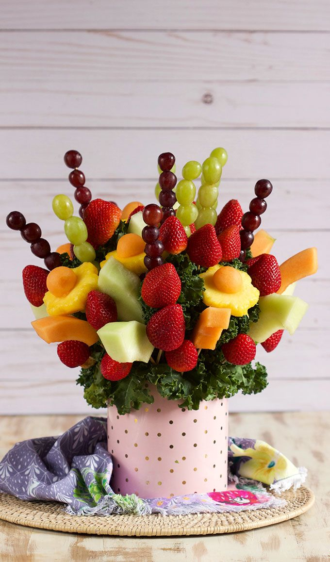 Super easy to make and inexpensive, this Edible Fruit Bouquet arrangement is the perfect gift for Valentine's Day, Mother's Day, birthdays or just about any occasion. A homemade gift your friends will love. Made with fresh ingredients you can find at your local grocery store. | @suburbansoapbox