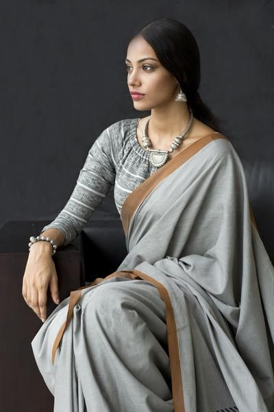 This gorgeous grey, brown and silver ensemble can take you from work to the party after dark. It carries rich motif work woven in in cotton, rayon and novelty yarn.