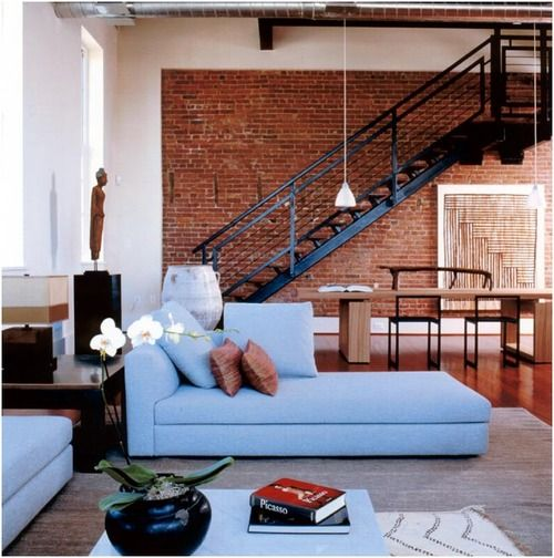 I love the warmth/rustic feel of exposed brick! Especially when balanced with more contemporary pieces (ie. mirrored furniture, chandeliers, etc.)