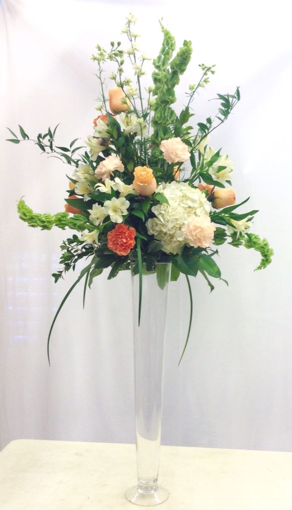 Coral and white tall reception centerpiece with larkspur