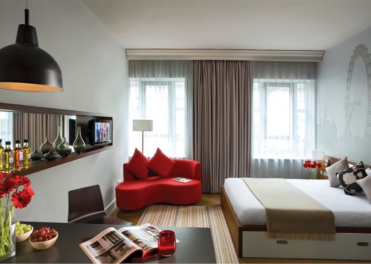 Interior Modern Apartment Design: Wheel Of Eye Modern Apartment With Glisten Artistic Design Ornaments Also Touch Red Daisy Flower Plus Similar Color Curvy Fabric Loveseat And Pale Gray Curtain
