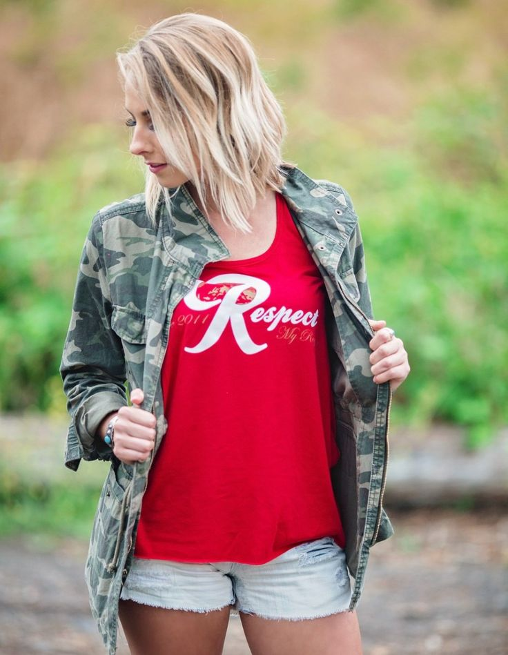 """By far one of our most popular designs, the Red """"Red R"""" tank pays homage to one of the Northwest's best known, um, weekend beverages. Featuring """"Respect My Region since 2011"""" in white and gold.  Flowy racer-back tank"""