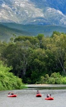 Breede River - Rafting Route 62. The Breede River in Robertson is arguably the most scenic section of river in the Western Cape.  Gentle enough for first timers, with enough rapids to make it exciting, this is for the whole family.