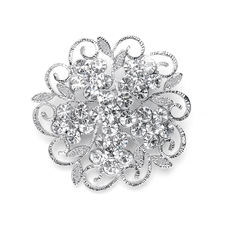 Thissparkling wedding or special occasion brooch is a beautiful filigree flower blazing with fiery clear crystals. The lacey brooch can be worn on gowns, bridal belts, sashes, faux fur wraps.