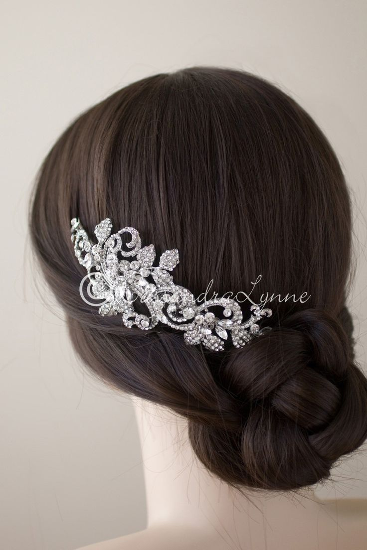 Add this bridal headpiece to your wedding day look and you will receive many compliments! It is a wonderful design of rhinestone covered swirls, marquise jewels and pave leaves. Attached to a comb wit