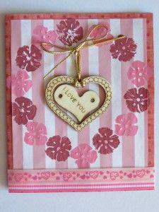 Steal your loved one's heart this Valentines Day with a sweet little card. The message of love portrayed by the wooden hearts will remind him just how special he is.  #FaveCrafter