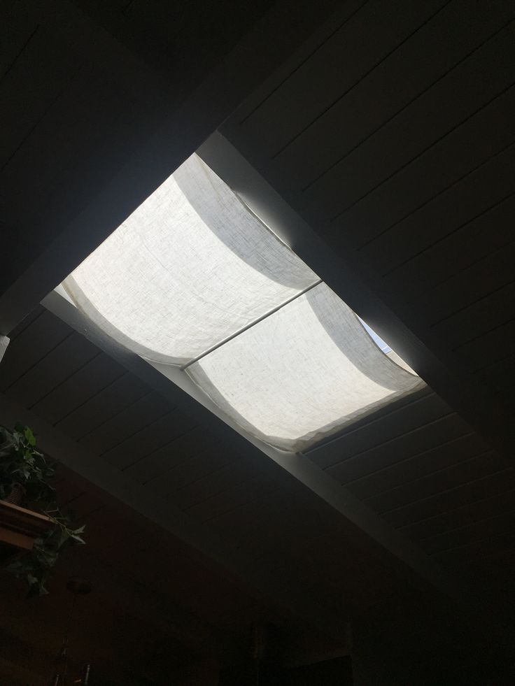 Skylight cover- a quick shade made with leftover materials and 3 $1.50 Daiso rods