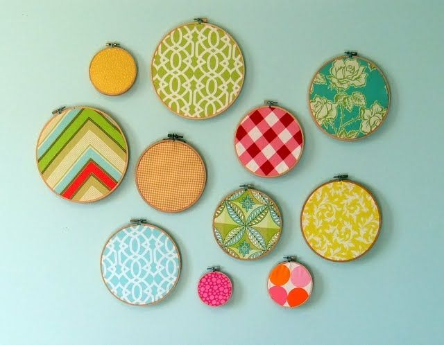 Embroidery hoops w/fabric. Such a simple DIY project for nurseries (or home decor)