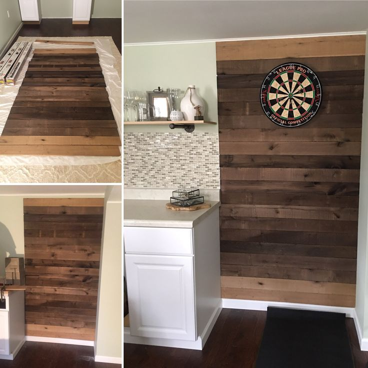 Basement --- Dart board. Process: purchased weathered poplar wallboards from Home Depot. Laid them out on the floor to achieve our desired pattern. Used a finishing nailer to attach to the wall. Hung dart board, purchases mat so new floors don't get ruined and Viola!