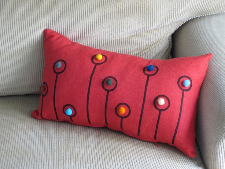 coral red linen pillow with dandelions and colorful felt balls  https://www.etsy.com/listing/105949489/coral-red-linen-pillow-case-embellished