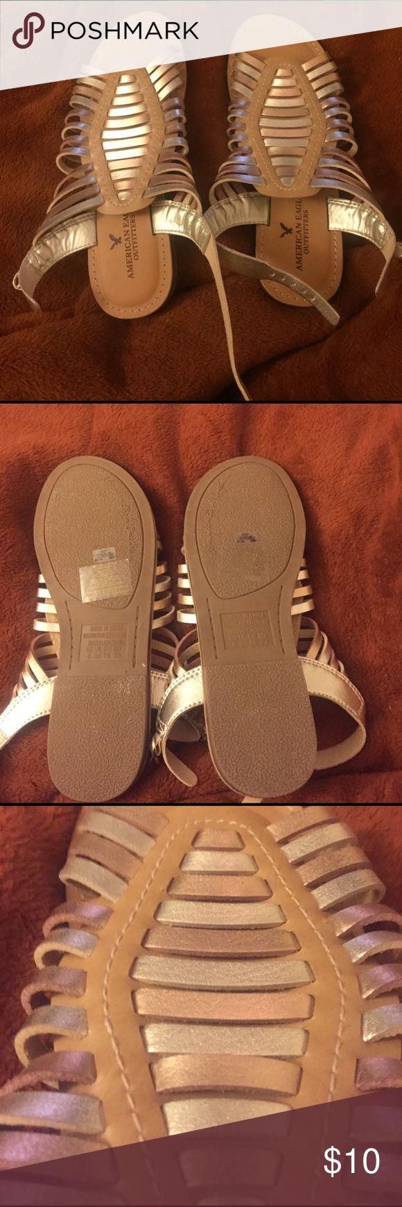Gold and silver strappy sandals Worn to a dance but never worn other than that. Very comfortable. American Eagle Outfitters Shoes Sandals