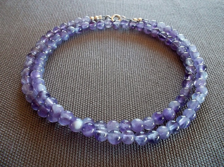Handcrafted necklace featuring 4mm genuine amethyst beads (light milky colour). 18 inches in length, with a sterling silver clasp.