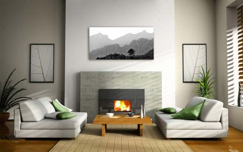 Black and white layered mountainscape artwork on a wall