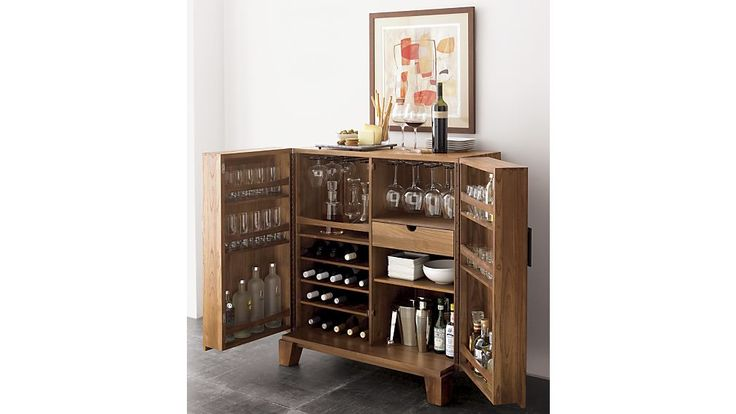 like the storage but the exterior is really plain and not interesting.  Also concerned it will stick out too far from the wall 37.5 x 22 x 42 Marin Bar Cabinet | Crate and Barrel $ 1299