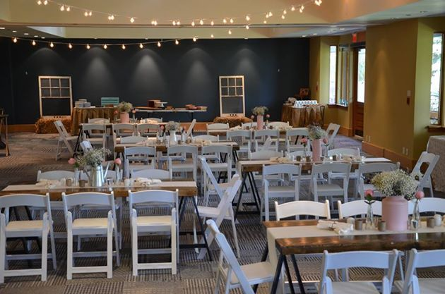 Indoor vintage farm house. White folding chairs, harvest tables. Transformation. Harvest tables