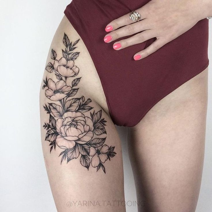 Upper leg Flower tattoo