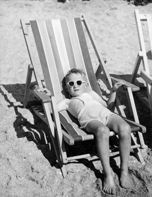Boy in a deck chair, photo by Kees Scherer 1950's
