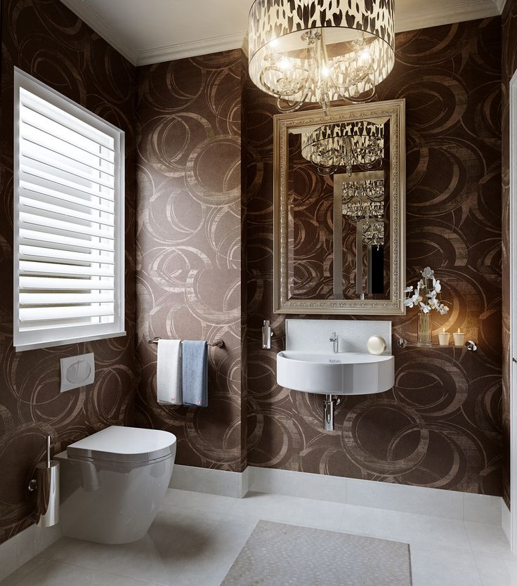 Architect Phil Darby suggests elegant bathroom vanities and stylish bathroom accessories for your Guest Bathroom, include a sleek glass shelf running alongside the basin for storing the finer luxuries, such as soap, lotion and scented candles for example.