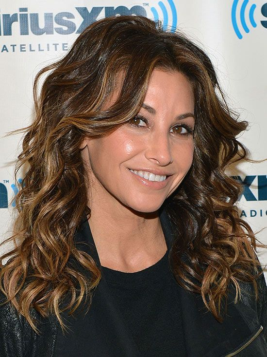 "As you age, ringlets tend to become dull and lifeless, Russo says. To get the spring back in your spirals, ask your stylist for a shoulder-length cut with layers throughout, like Gina Gershon's 'do. ""If your cut doesn't have any layer or dimension to it -- it will look too boxy,"" he says."
