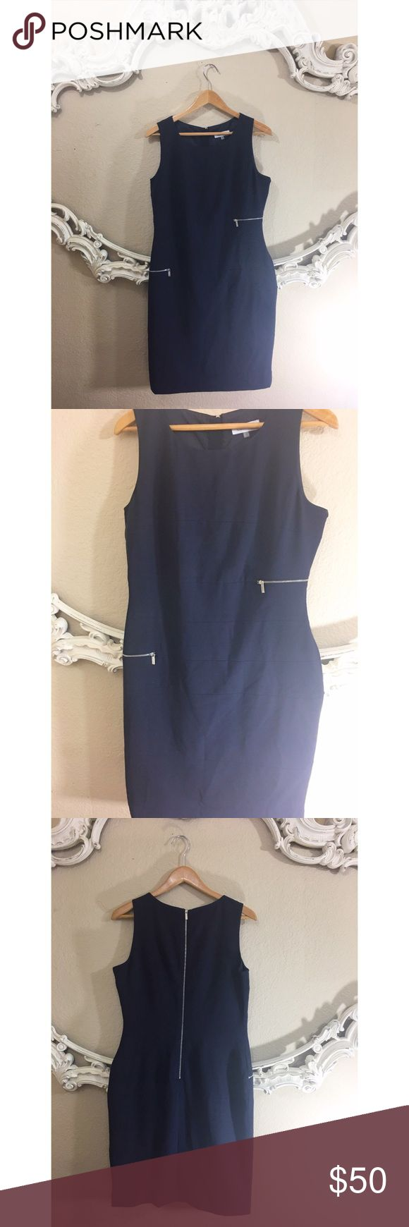 Calvin Klein Navy career sheath zipper dress Excellent condition. Navy blue sleeveless dress with silver zippers in front and zip down back. No trades. Calvin Klein Dresses