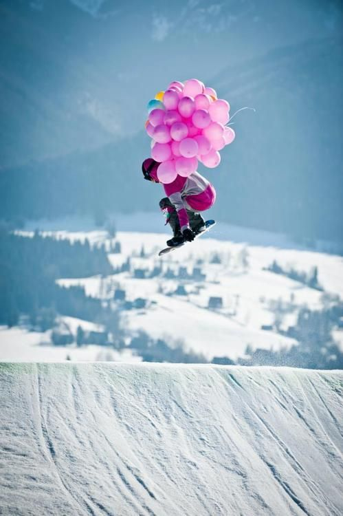 Snowboarden with Pink Ballons