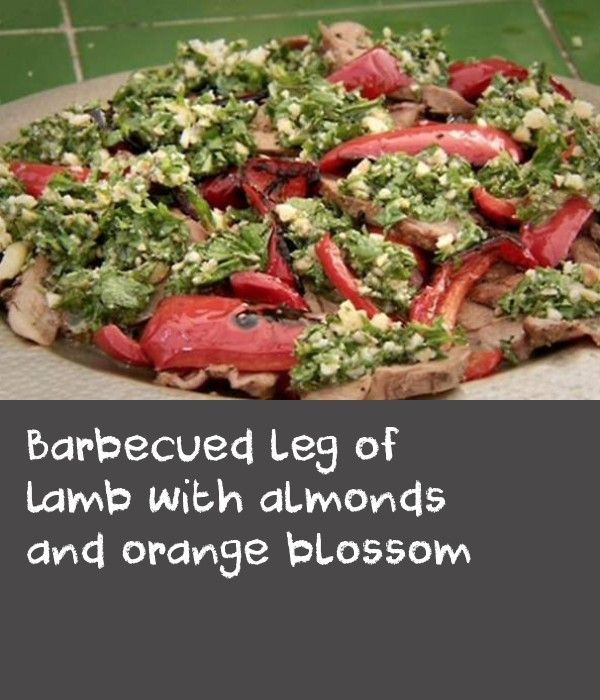 Barbecued leg of lamb with almonds and orange blossom | This Moroccan recipe looks fantastic when served on a large platter over a bed of fresh parsley (leaves and stalks). You can sear the lamb, grill the capsicum and make the sauce (without the herbs) all in advance, then finish the lamb and add the herbs to the sauce at the very last minute.