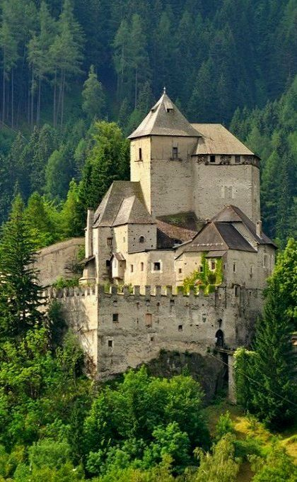 """Reifenstein Castle is a castle in South Tyrol (northern Italy). From the 12th century. It is famous for the decorated """"Green Hall"""" with Gothic paintings and a woodcarved chapel-door, the stubes and the collection of armor. The castle also contains an original kitchen, bathroom and medieval sleeping bunks."""