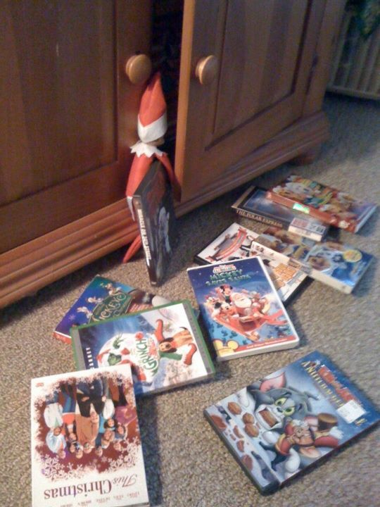 Elf picking out a Christmas movie to watch