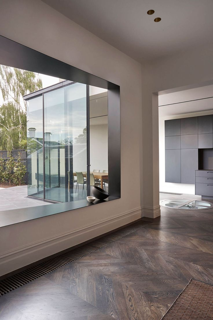 Victorian house colorful interiors for a classy exterior south yarra - A Minimal Palette Of Stained Oak Parquetry Local Bluestone Dark Mirrors Unifies The Interior Of This Victorian Terrace Renovated By Edwards Moore