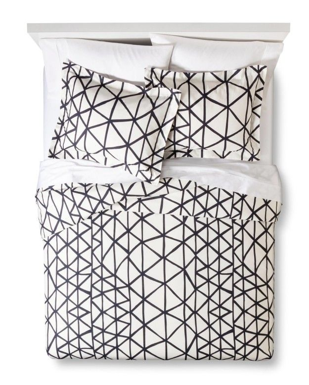 Stir up envy (and likes) amongst your Instagram followers while posing on this chic-AF Nate Berkus geo duvet set.