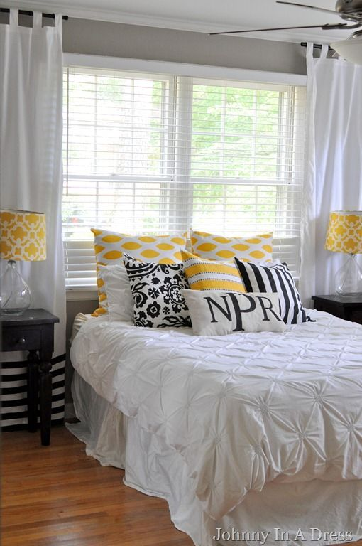 Not sure how I feel about the yellow accents, but I like the white comforter and white curtains with the gray walls.