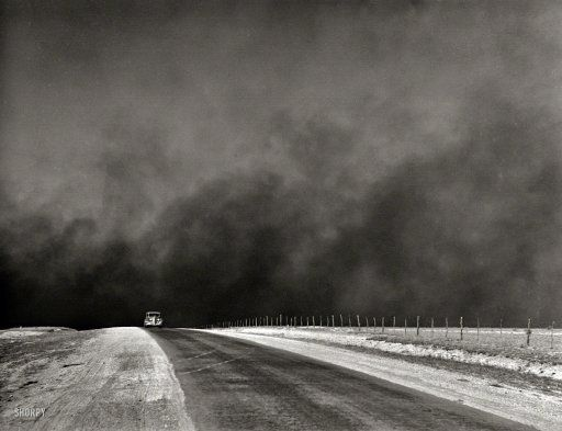"March 1936. ""Heavy black clouds of dust rising over the Texas Panhandle"" — evidence of the forces that were driving thousands of farm families in Texas and Oklahoma to the West Coast in the great Dust Bowl migration chronicled in ""The Grapes of Wrath."" Medium format negative by Arthur Rothstein."