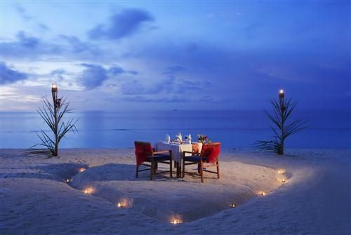 Dinner at sunset in Honeymoon Maldives...