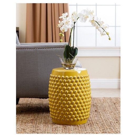 Add a stylish, unexpected flair to any garden, patio or outdoor space with the Sophia Yellow Pierced Ceramic Garden Stool from Abbyson Living. You'll love the texture of this pierced ceramic garden stool as an accent piece in your garden or patio. Boasting a bright yellow hue, this garden stool is sure to make any outdoor space unique.