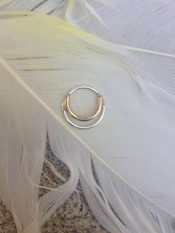 Silver and 14 k gold septum ring by theglorious on Etsy, $75.00