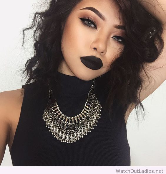 Great grunge make up with black lips