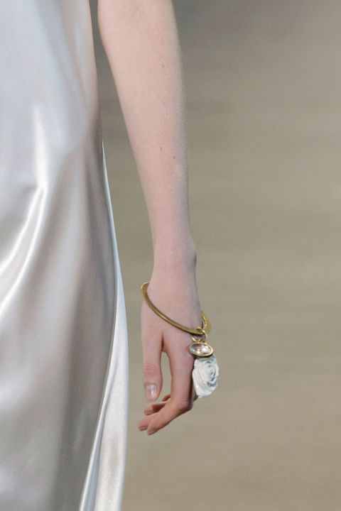 spring jewelry trend 2016 The bracelet is back, and it's all about the bangle that doesn't require layering—but that doesn't mean you can't.  Pictured: Calvin Klein