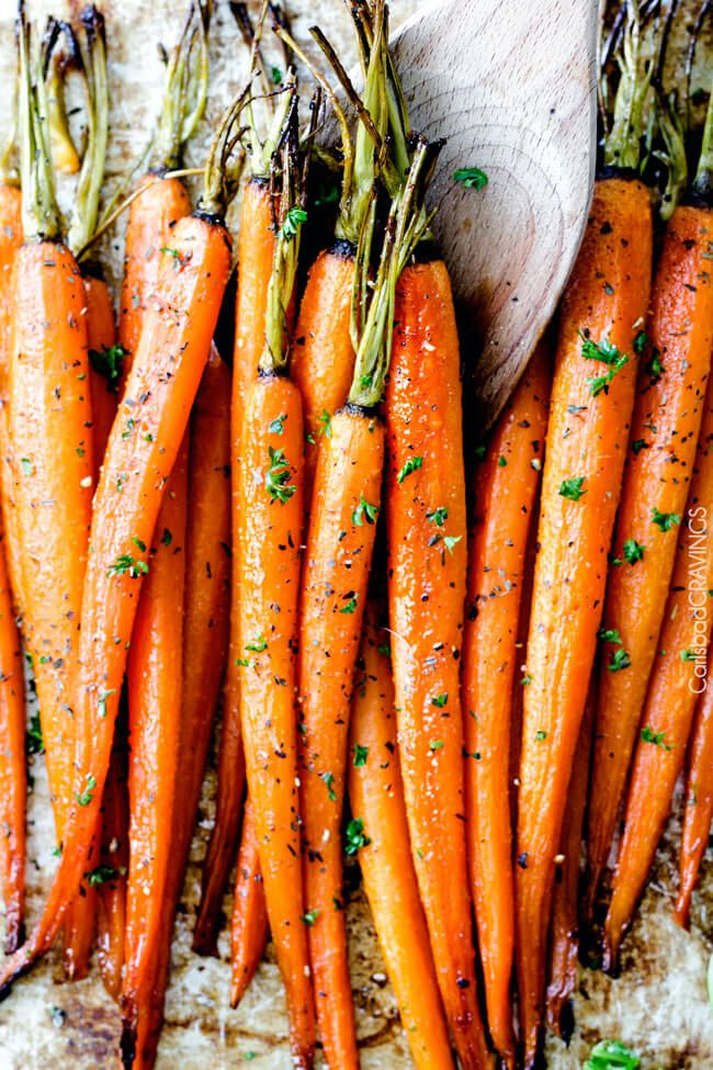 Tender, sweet and savory Secret Ingredient Honey Garlic Roasted Carrots are the most delicious carrots and easiest side dish EVER (think Easter!) with only 10 minutes prep! I eat these like candy!