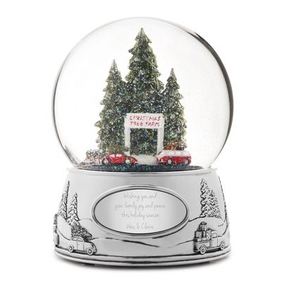 The personalized Christmas Tree Farm Snow Globe is the perfect gift for anyone this holiday season. Wind up this festive snow globe and start a wintery scene featuring red cars revolving around a Christmas tree farm. Additionally, this snow globe plays 'Der Tannenbaum' as it rotates. Engrave the front plate with a name or special holiday message.  https://www.thingsremembered.com/product/Christmas-Tree-Farm-Snow-Globe/178581.uts