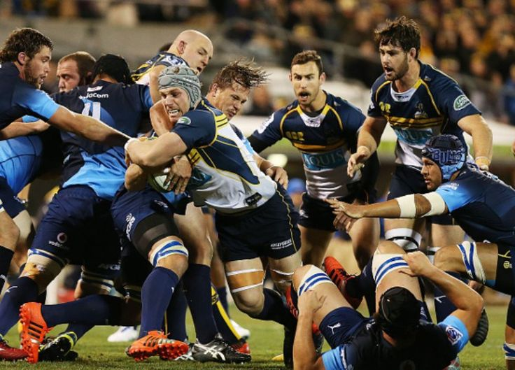 Brumbies 22 vs 16 Bulls David Pocock of the Brumbies is tackled during the round 16 Super Rugby match between the Brumbies and the Bulls at GIO Stadium on May 29, 2015 in Canberra, Australia.