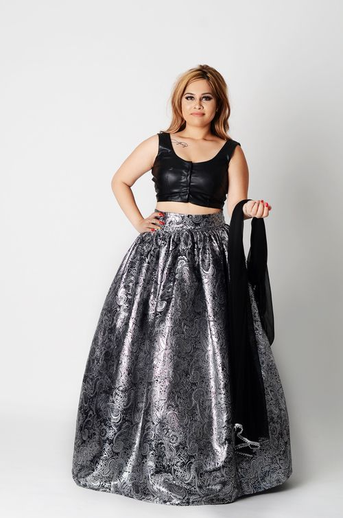 ndian wear in leather and metallics. A trendsetter  from our Sephora Bridal collection. Silver and black metallic against that faux leather blouse, nothing subtle about this one. Dare to wear me? Alterable to size. Duppatta accented with a subtle silver trim.