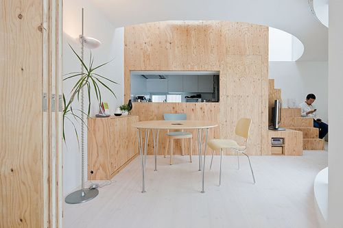 Add Some Warmth: 12 Plywood Interiors \\\ Photo by Iwan Baan. House OM in Yokohama, Japan, designed by Sou Fujimoto Architects, has a dining space lined with a plywood wall that pierces a circle in the ceiling. Plywood stairs make the climb, eventually up to the rooftop.