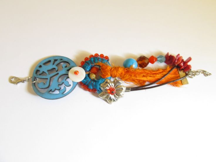 Handmade textile leather bracelet (1 pc)  Made with turquoise laser cut leather filigree, silk fabric pieces, handmade hoop with wire and beads, metal flower, turquoise stone, corals, glass beads, leather cord and mother of pearl.