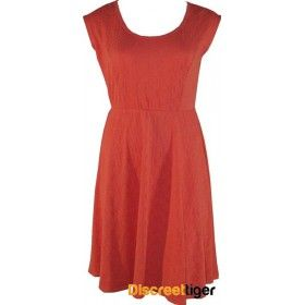 This is a really cute piece, a coral matelasses skater dress with a nice rounded neckline that will suit most girls. Comfortable cap sleeves with a fitted bust area and a wistful flared skirt that sits just above the knee. Add in the slit cut-out at the back for a little bit of show and tell and this is just a must have.